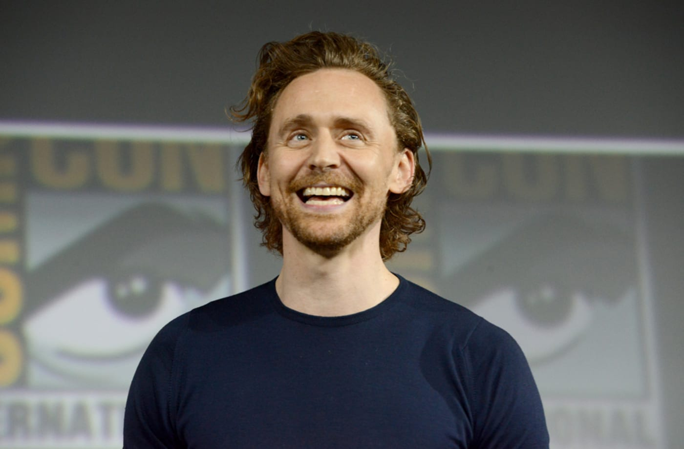 Tom Hiddleston speaks at the Marvel Studios Panel during 2019 Comic Con