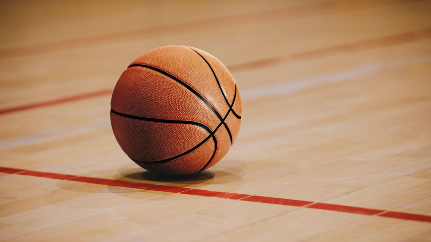 Basketball on a high school court.