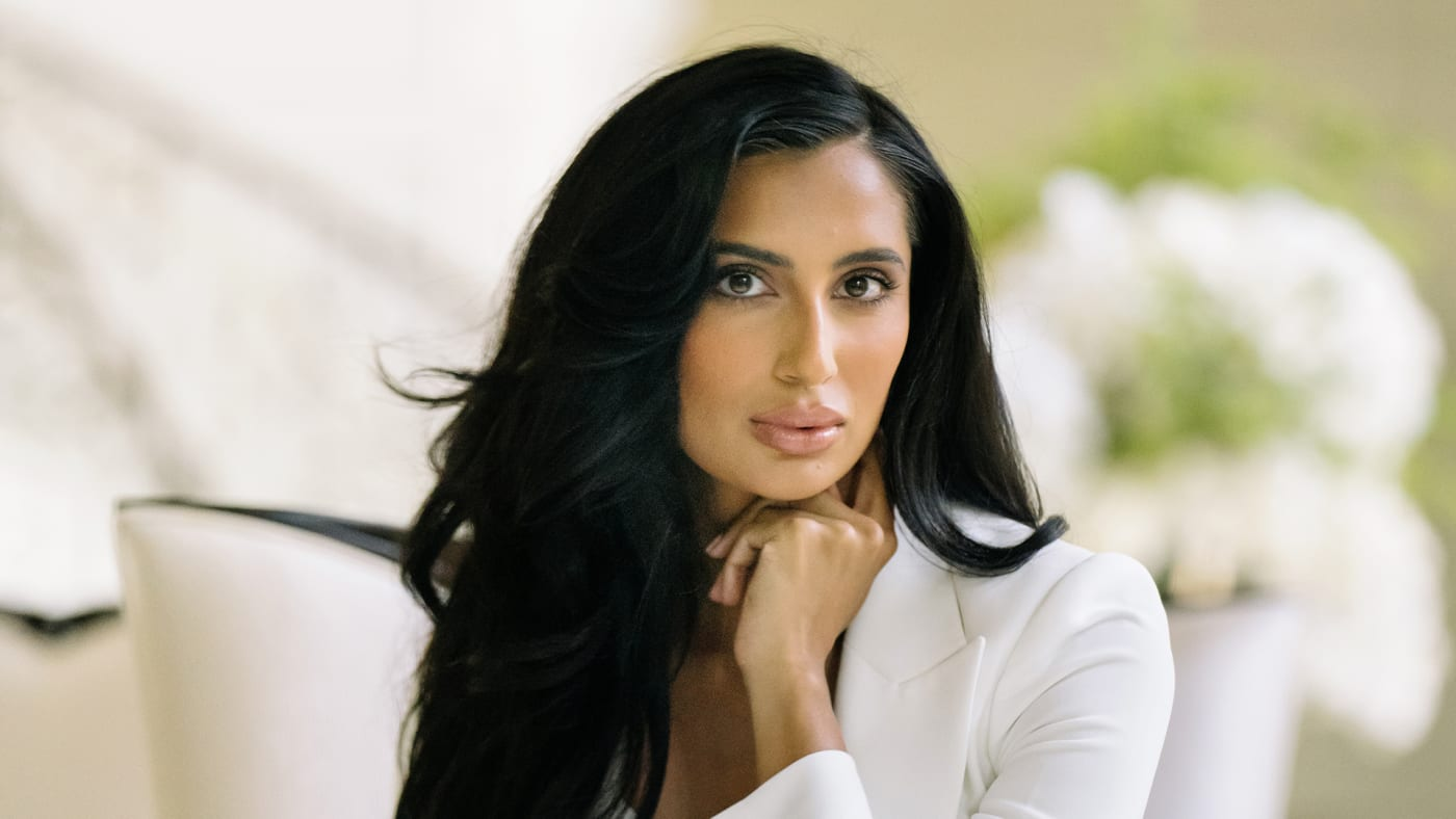 Nisha Grewal in a white suit