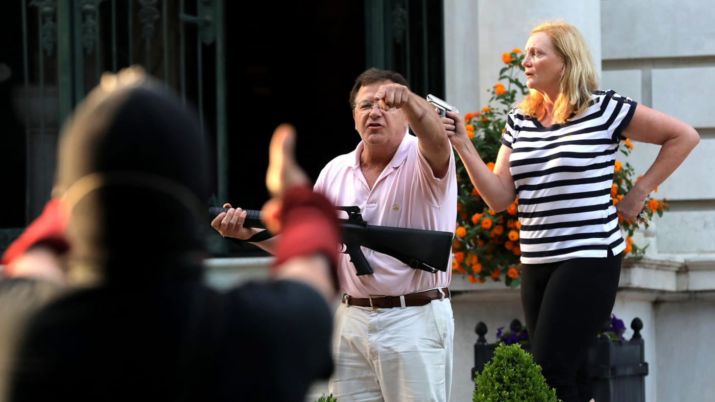 St. Louis couple pointing guns at peaceful protesters.