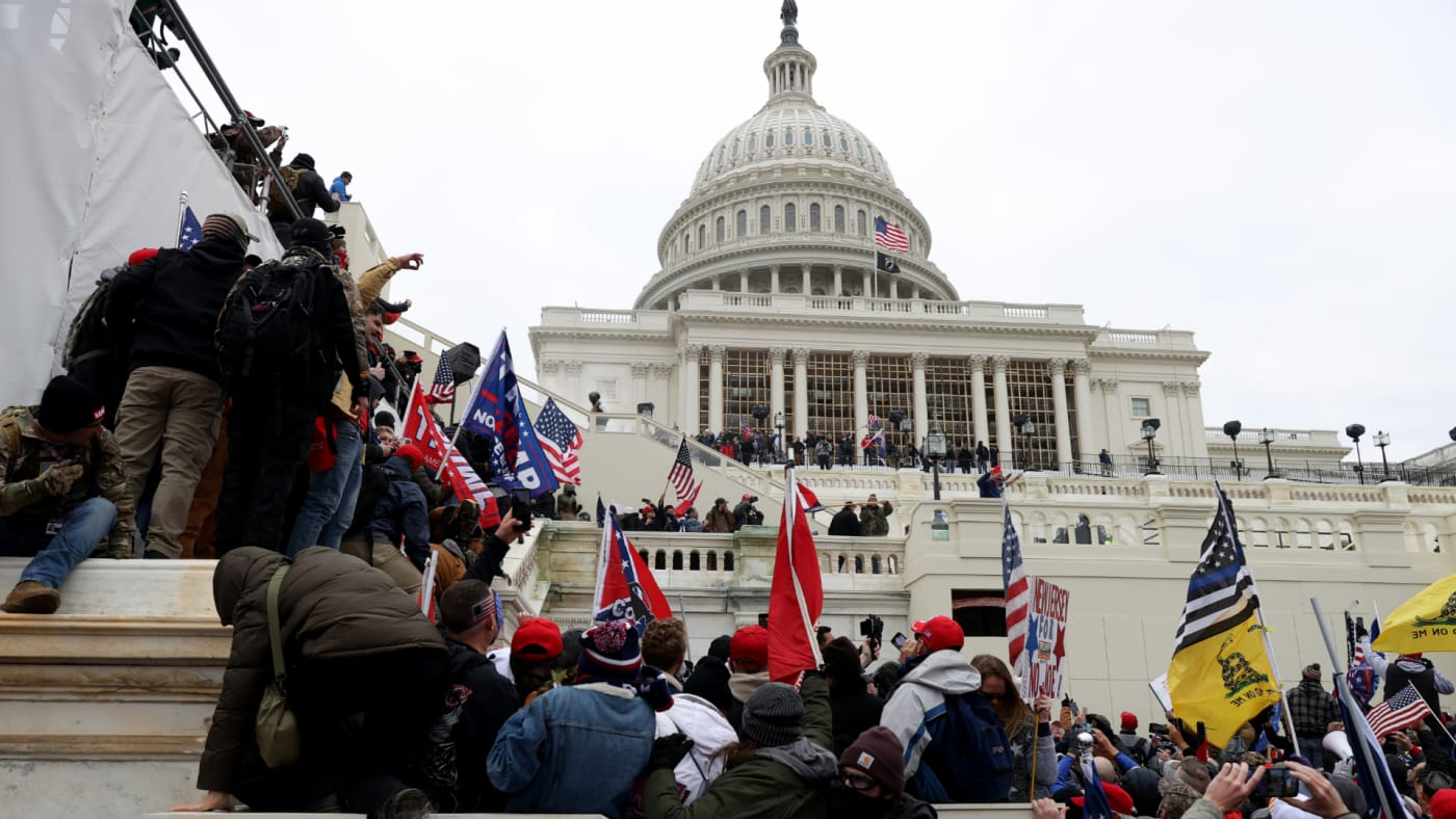 Protesters gather outside the U.S. Capitol Building.