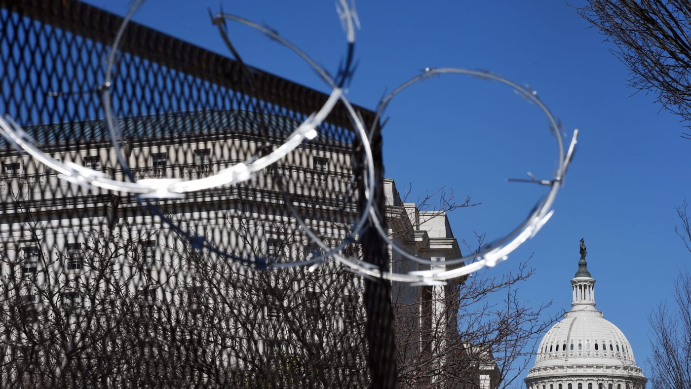Razor wire is seen on fencing near the US Capitol Building on Capitol Hill