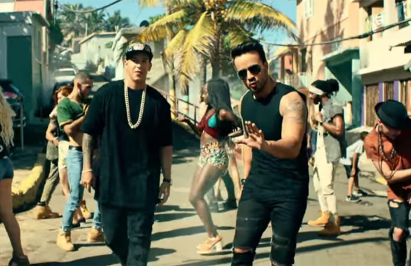 A stillshot of Despacito's music video.