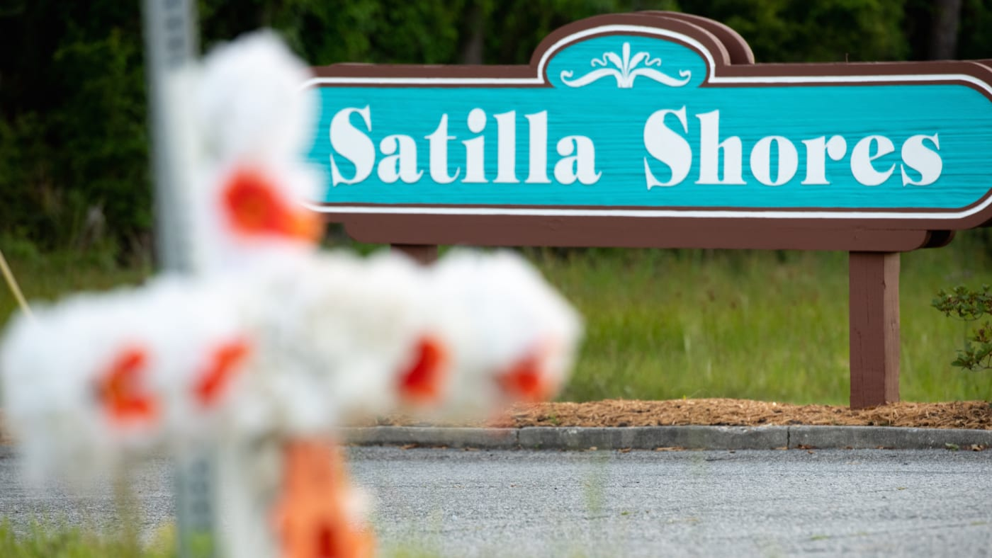 """A cross with flowers and a letter """"A"""" sits at the entrance to the Satilla Shores"""