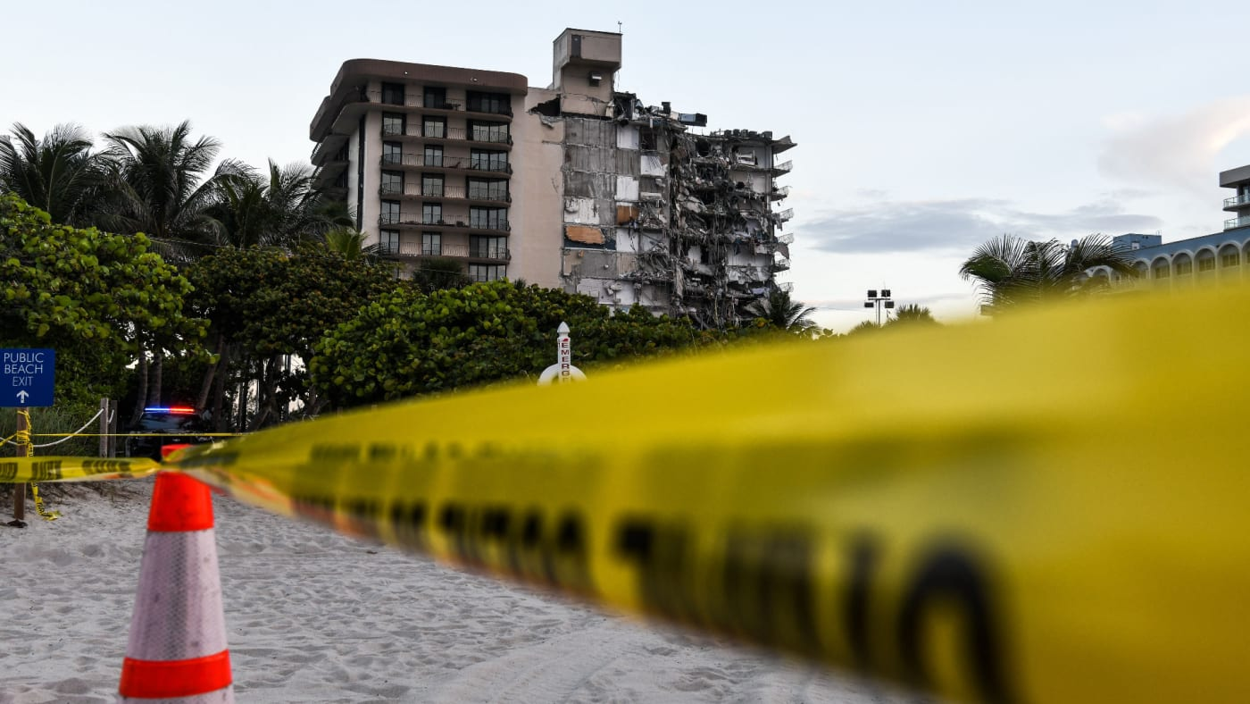 Police tape blocks access to a partially collapsed building in Surfside north of Miami Beach.