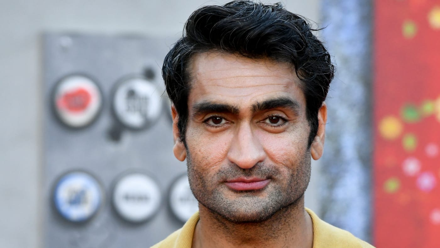 Kumail Nanjiani poses for photo on red carpet during 'The Suicide Squad' premiere.