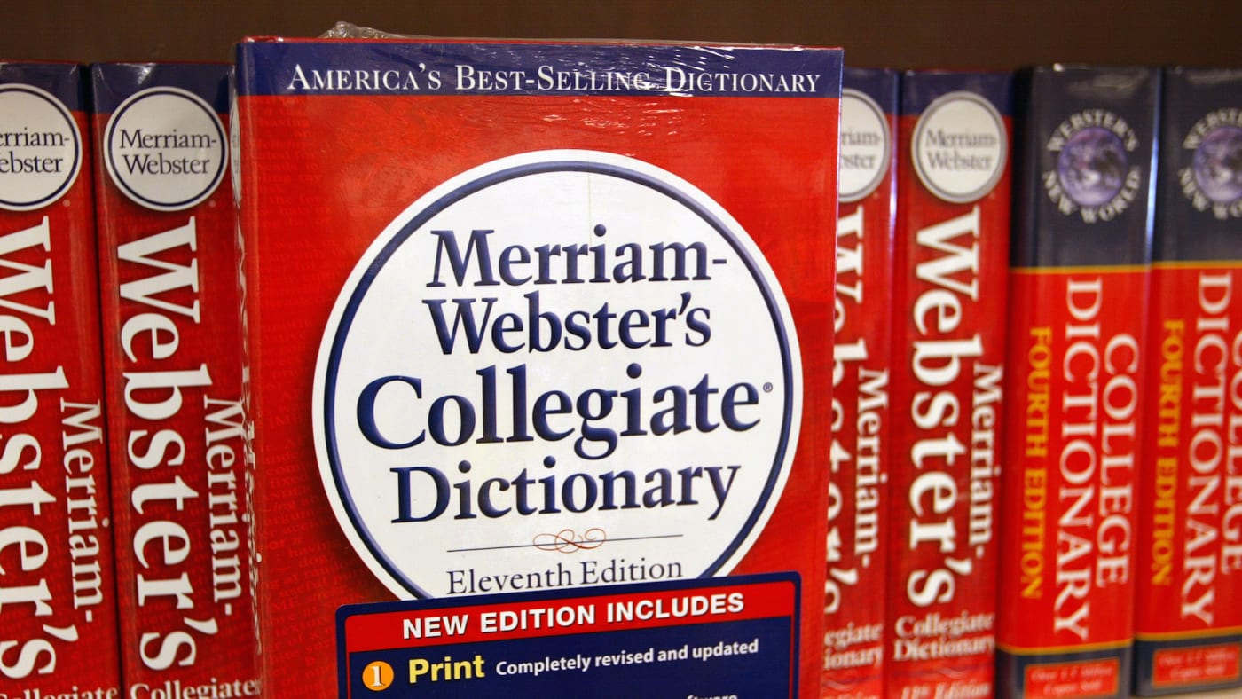 A Merriam Webster's Collegiate Dictionary is displayed in a bookstore.