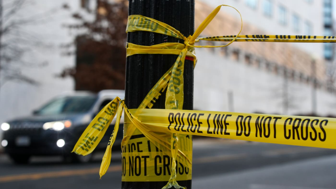 A yellow tape is pictured in a blocked street near the US Capitol Building.