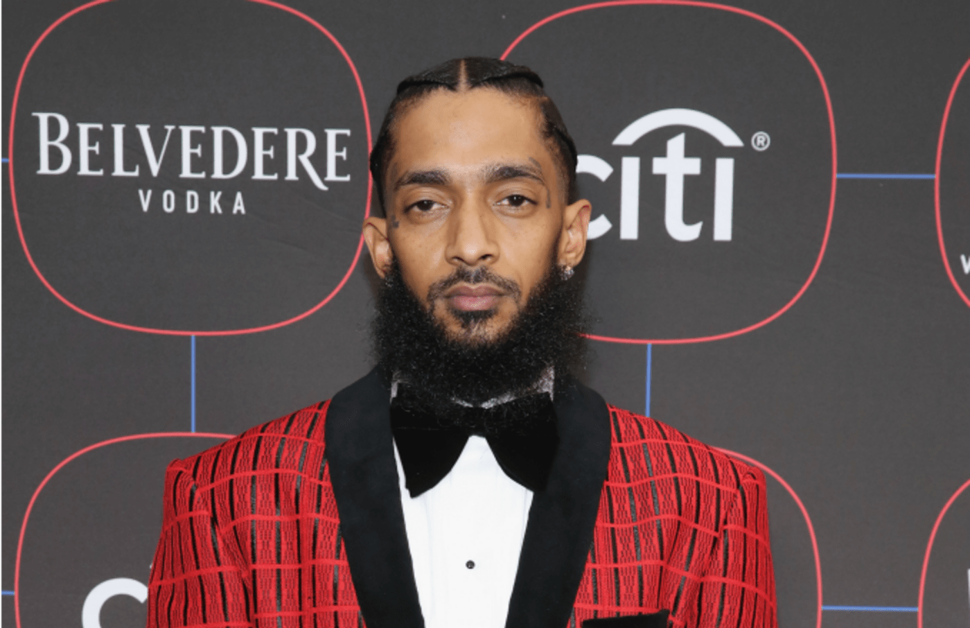 Nipsey Hussle attends the Warner Music Pre Grammy Party