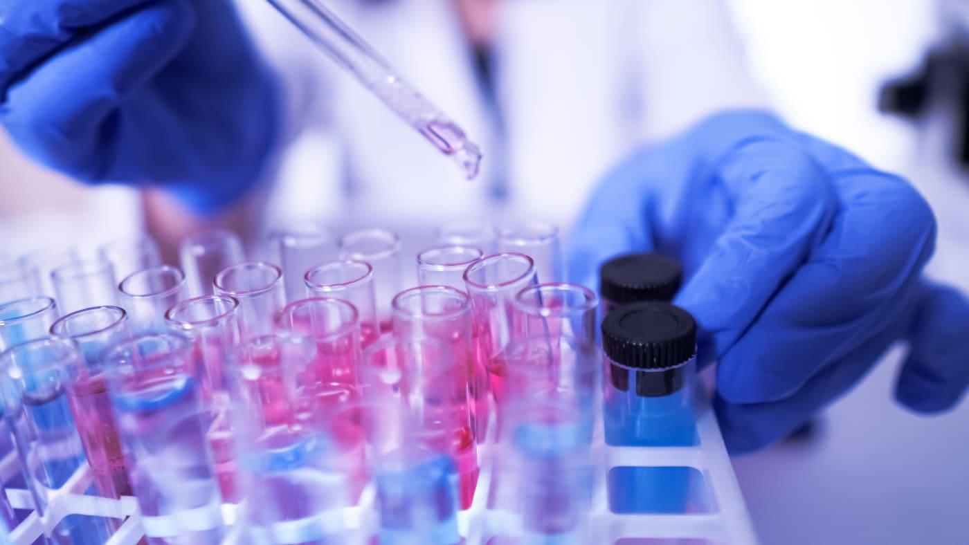 Lab technician conducts coronavirus research.
