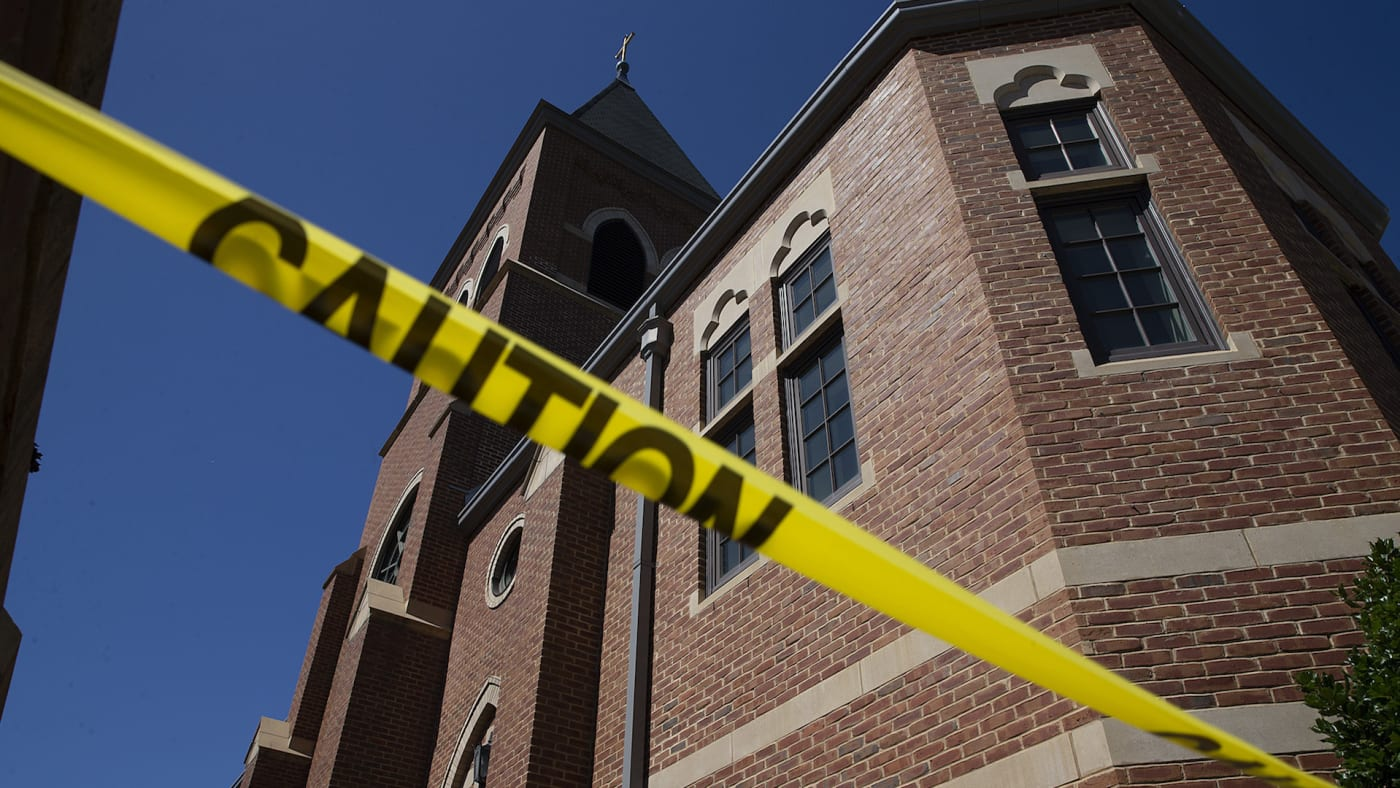 Caution tape in front of the Sacred Heart Church