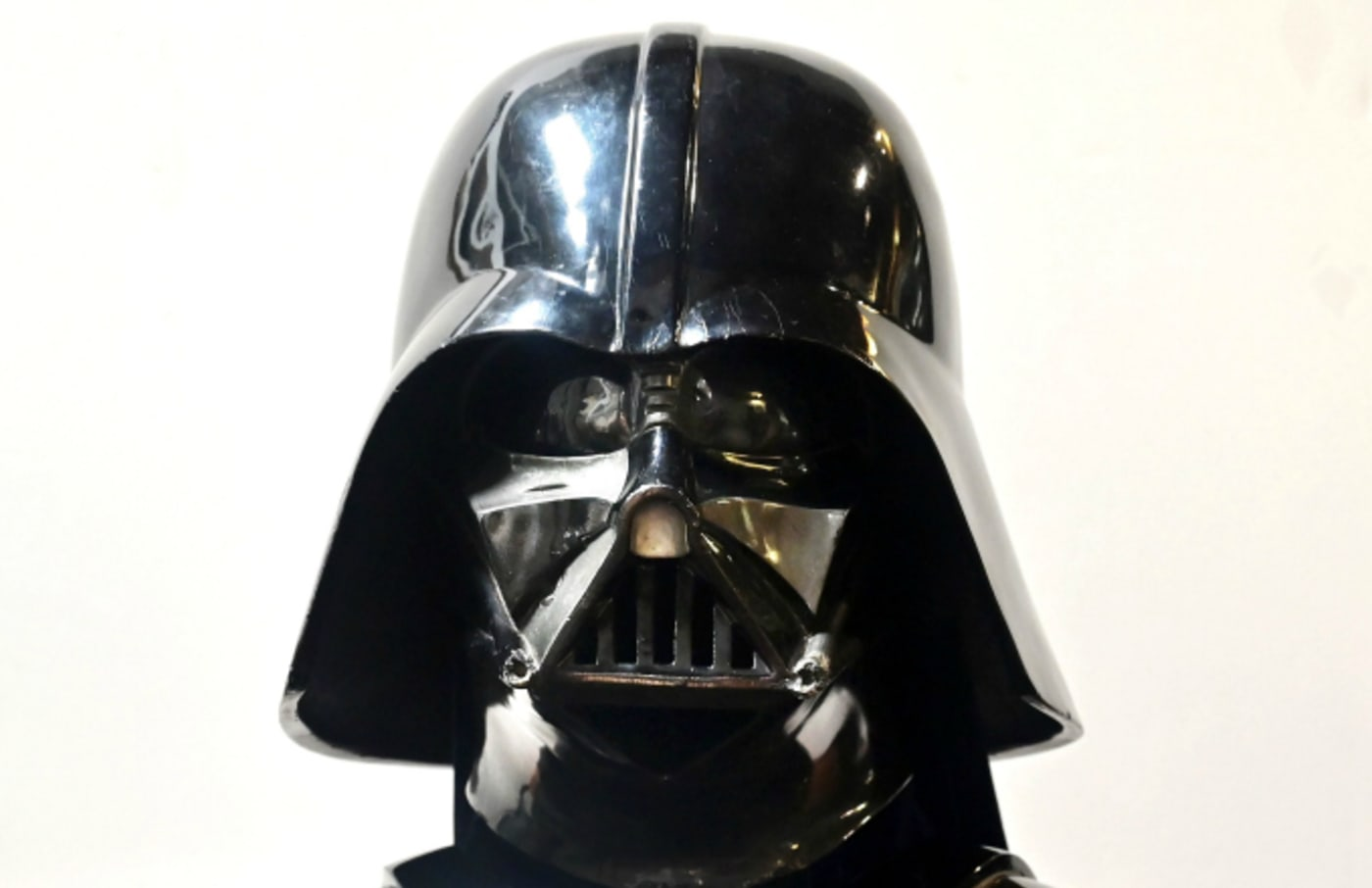 """A Darth Vader helmet and mask from the film """"The Empire Strikes Back"""" on display"""
