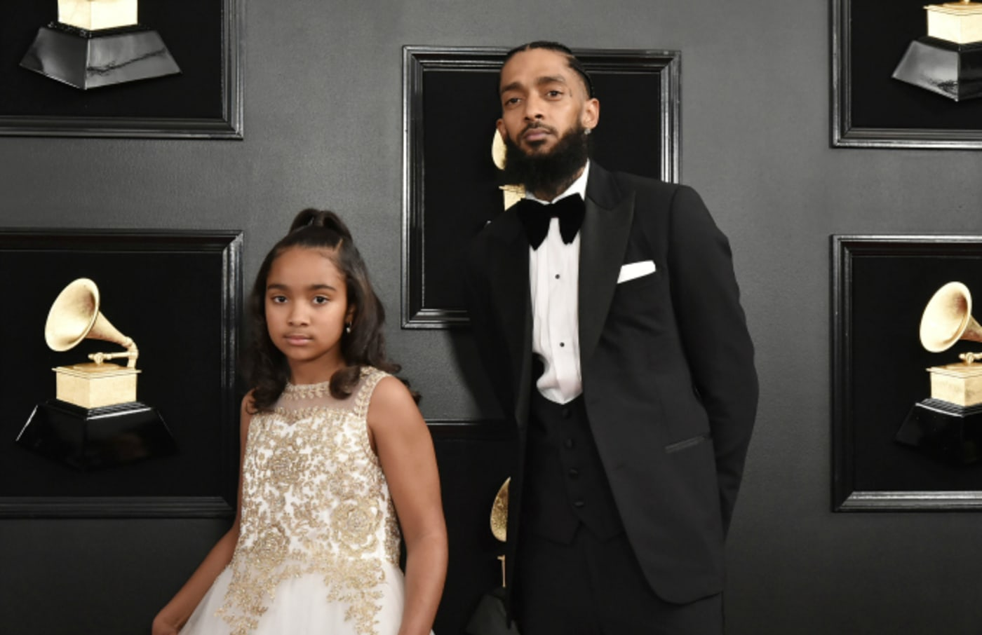 Emani Asghedom and Nipsey Hussle attend the 61st Annual Grammy Awards