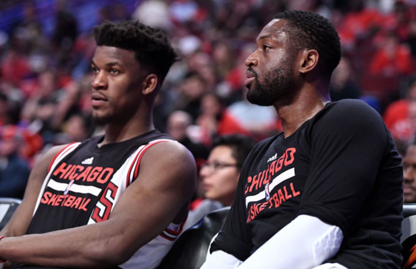 Jimmy Butler and Dwyane Wade sit on the Bulls bench.