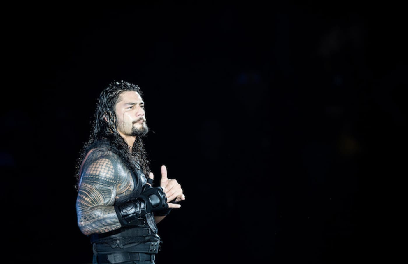 Roman Reigns reacts during to the WWE Live Duesseldorf event.