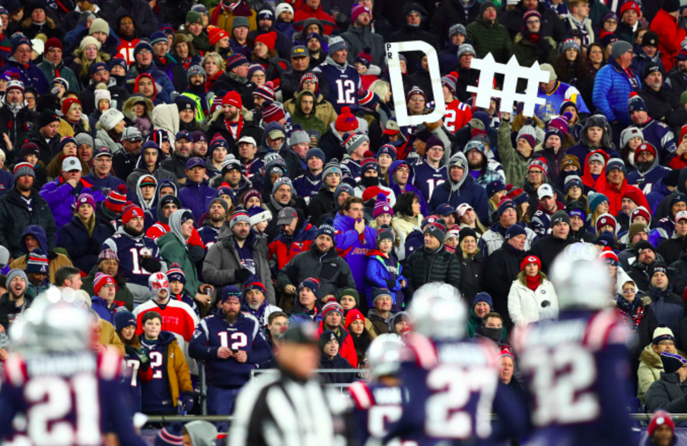 Fans hold a sign for the New England Patriots
