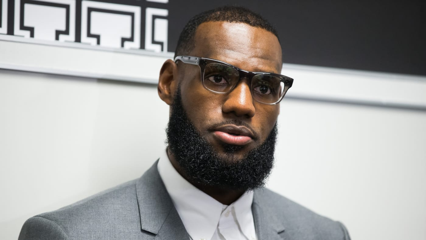 LeBron James addresses media following the grand opening of I Promise school.