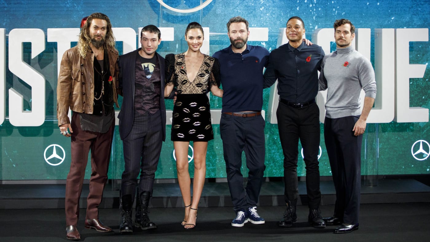 'Justice League' cast pose for a photograph at a photocell.