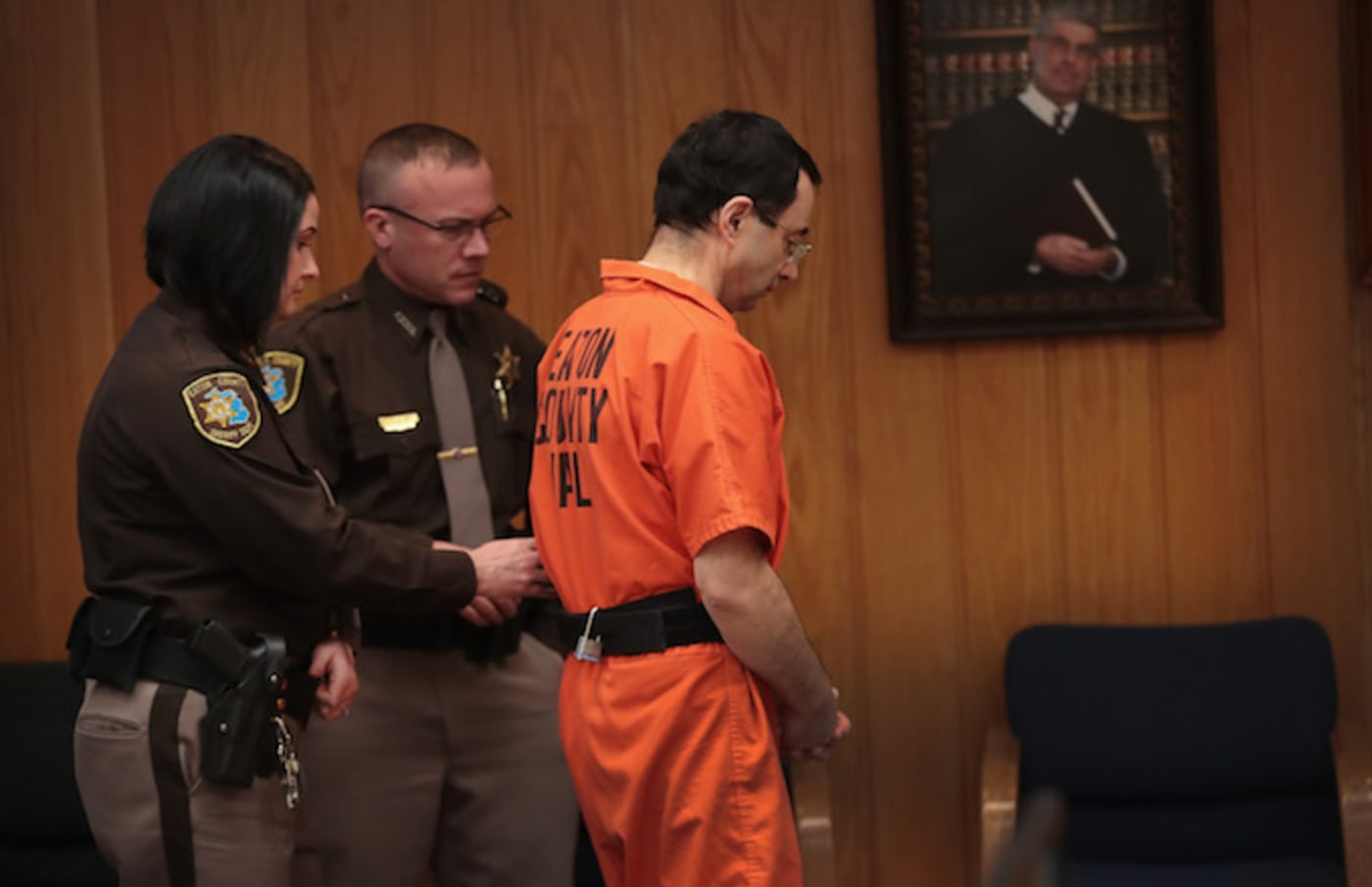 Larry Nassar is led from the courtroom
