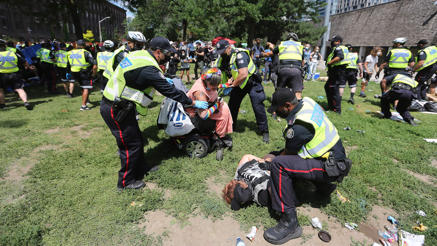 Protesters are arrested after Police removed residents and homeless advocates are removed from Lamport Stadium.
