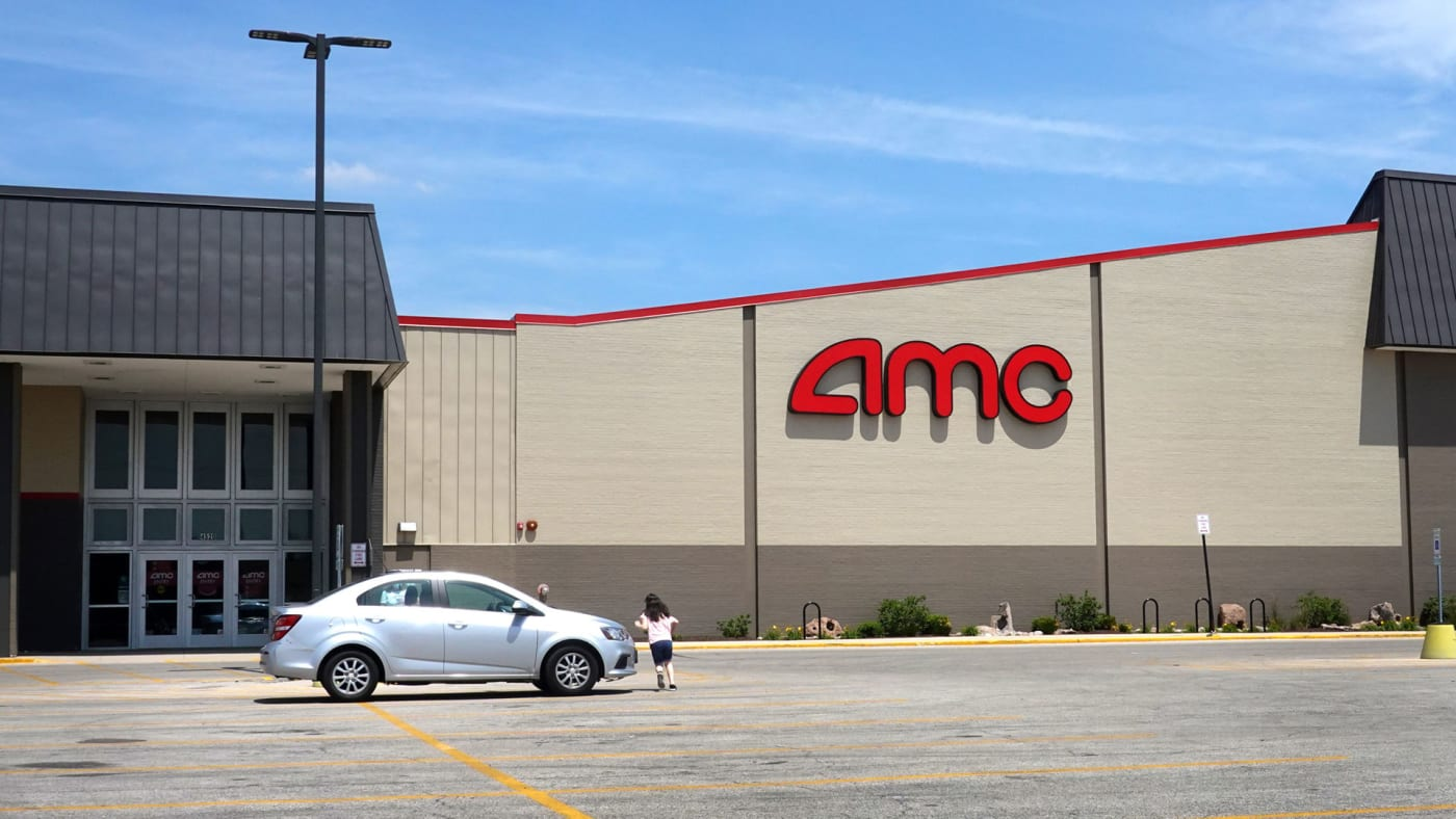 A nearly empty AMC Theatres parking lot.