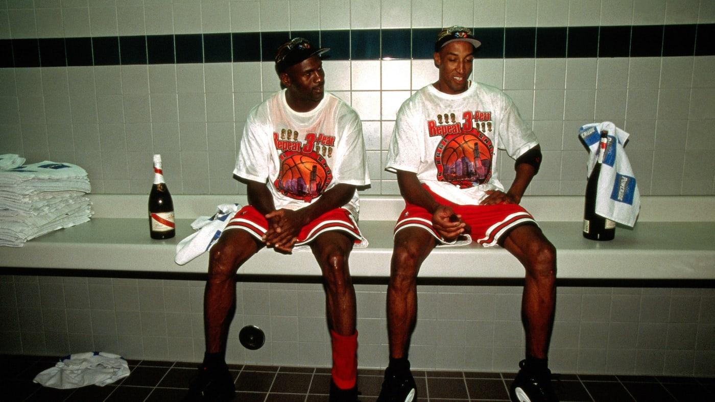 Michael Jordan and Scottie Pippen celebrate in the locker room after winning 1998 NBA Championship.
