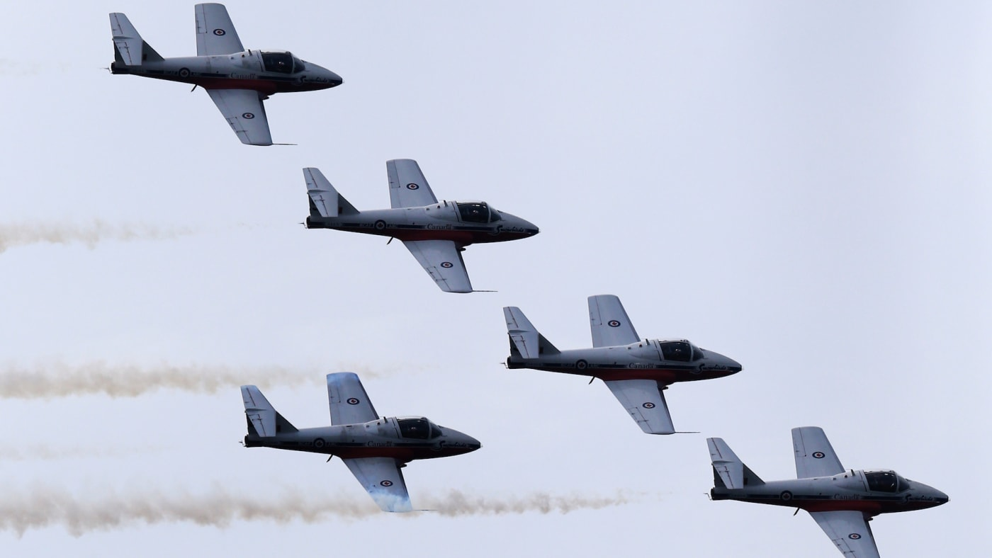 Canadian Forces Snowbirds fly over Toronto skies as part of Canadian International Airshow.