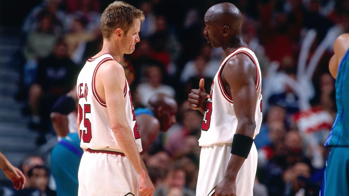 Michael Jordan #23 of the Chicago Bulls talks to Steve Kerr #25