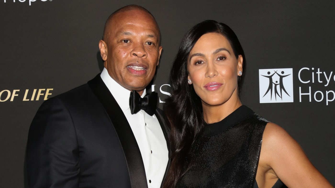 Dr. Dre (L) and his Wife Nicole Young (R) attend the City Of Hope Gala.