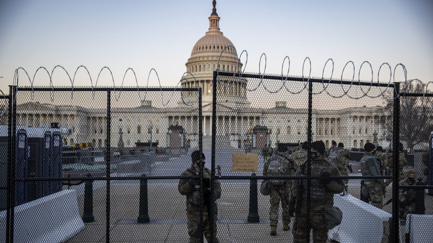The US Capital is seen as National Guard secure the the grounds