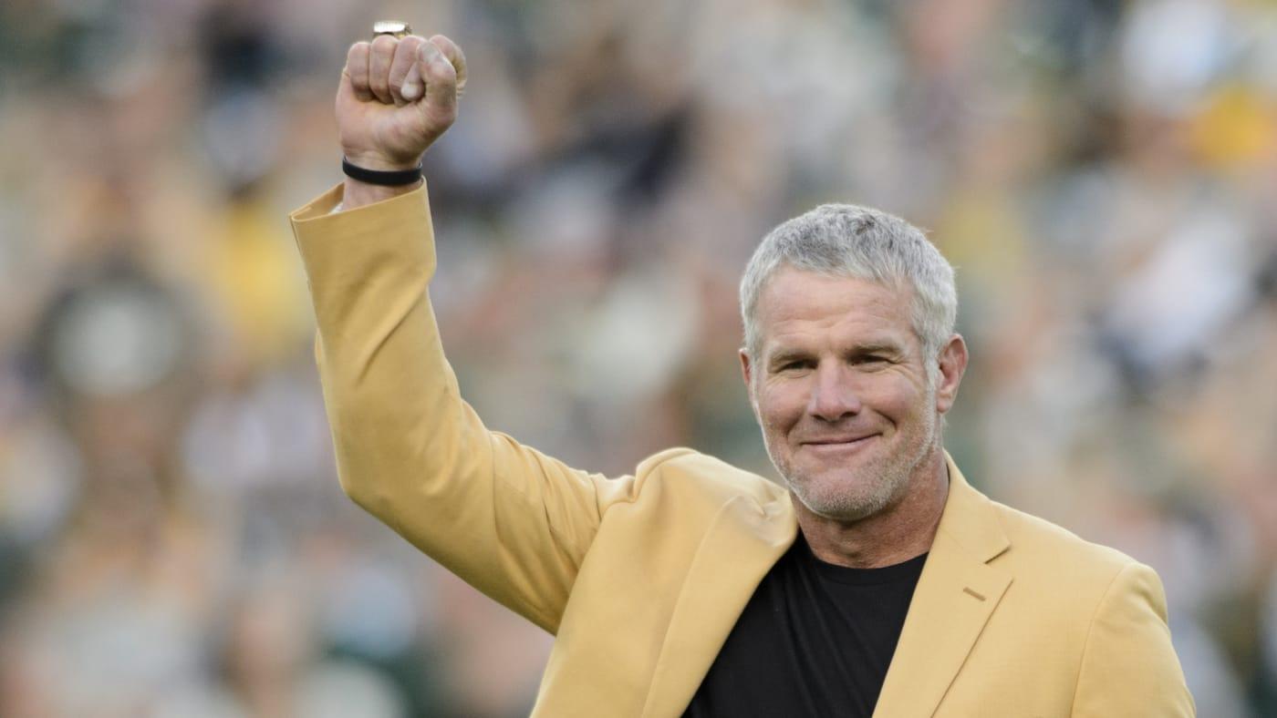 Former NFL quarterback Brett Farve looks on