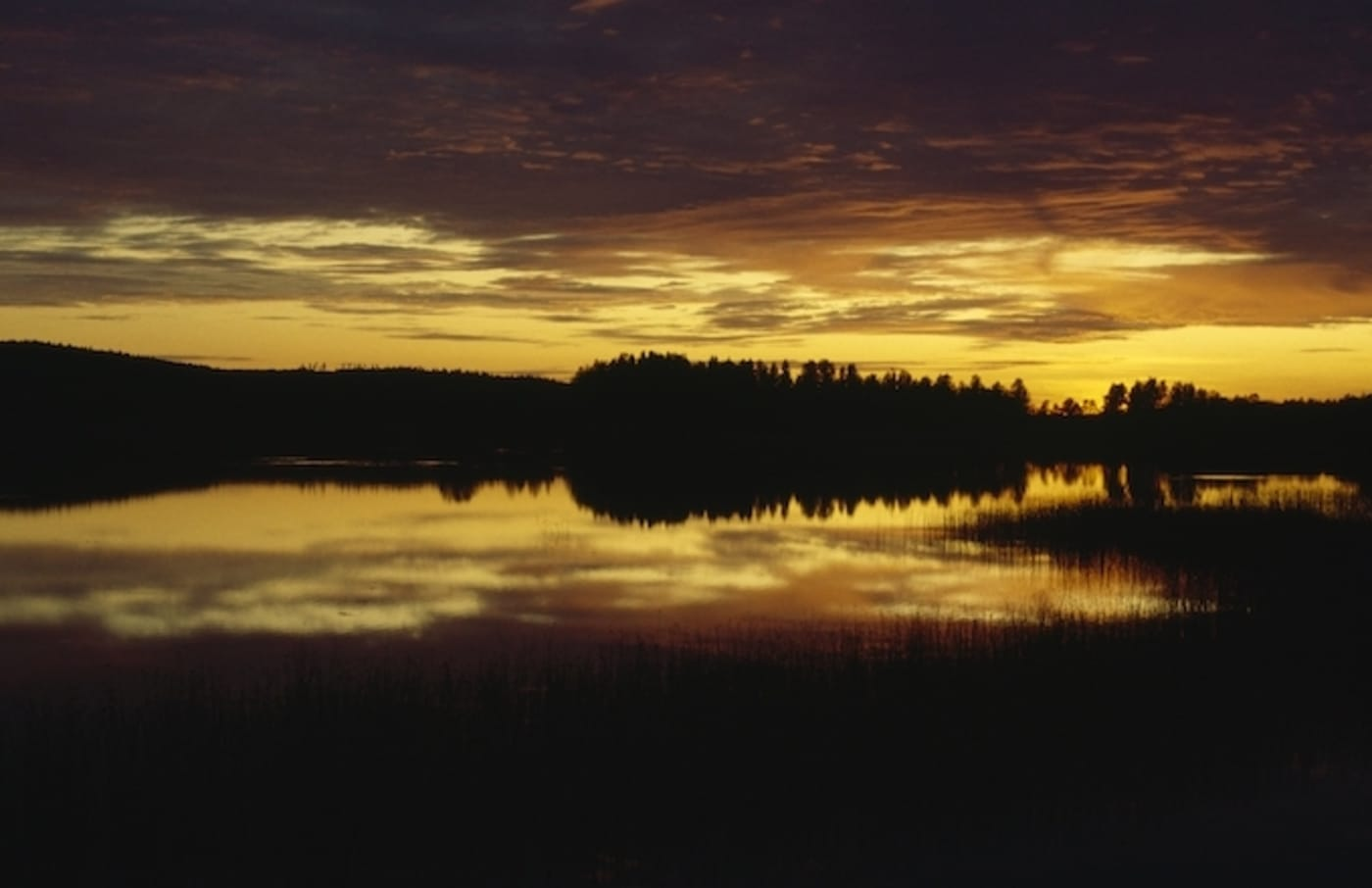 Sunset and clouds over a lake, Lakeland, Finland.