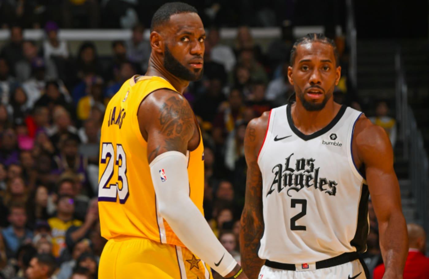 LeBron James #23 of the Los Angeles Lakers and Kawhi Leonard