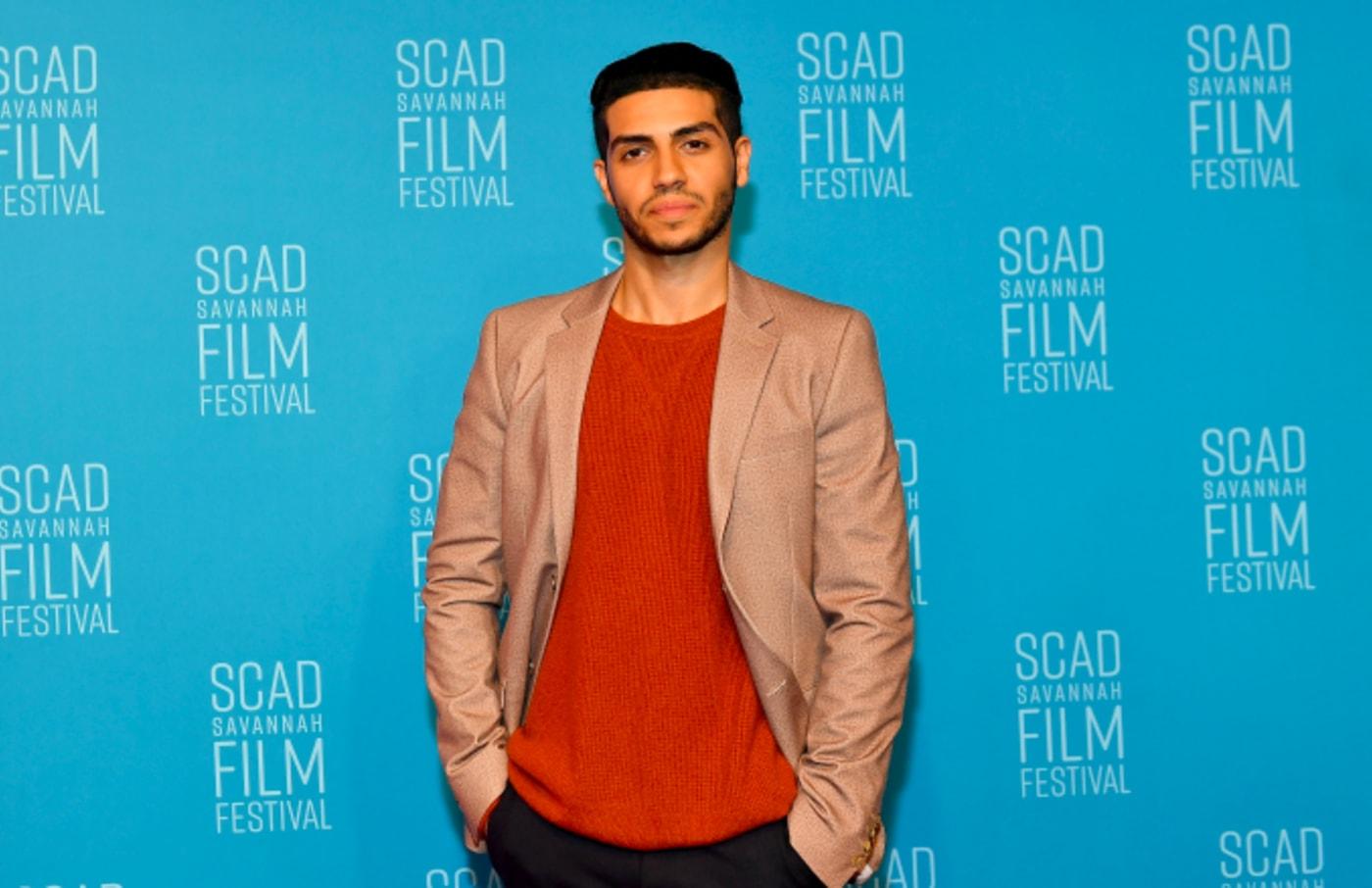Actor Mena Massoud attends 22nd SCAD Savannah Film Festival
