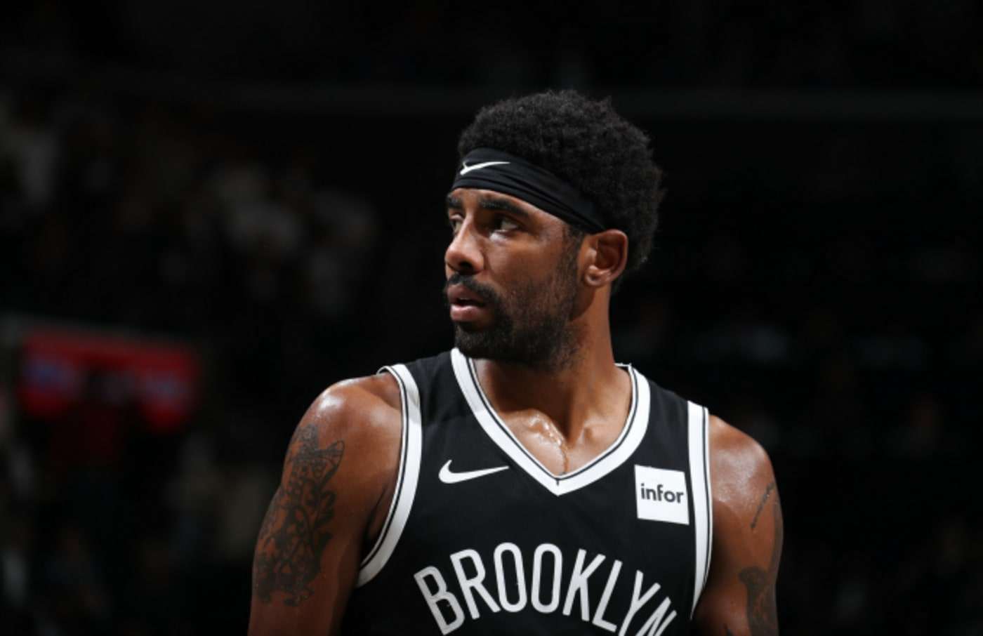 Kyrie Irving #11 of the Brooklyn Nets looks on against the New York Knicks