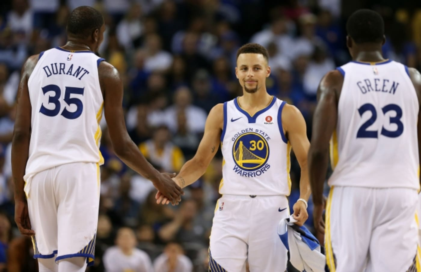 Warriors players during their first game of the season against the Rockets.