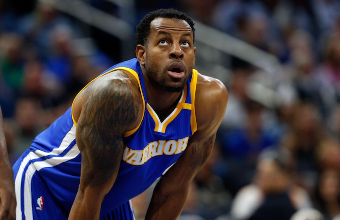 Andre Iguodala puts his hands on his knees during game.