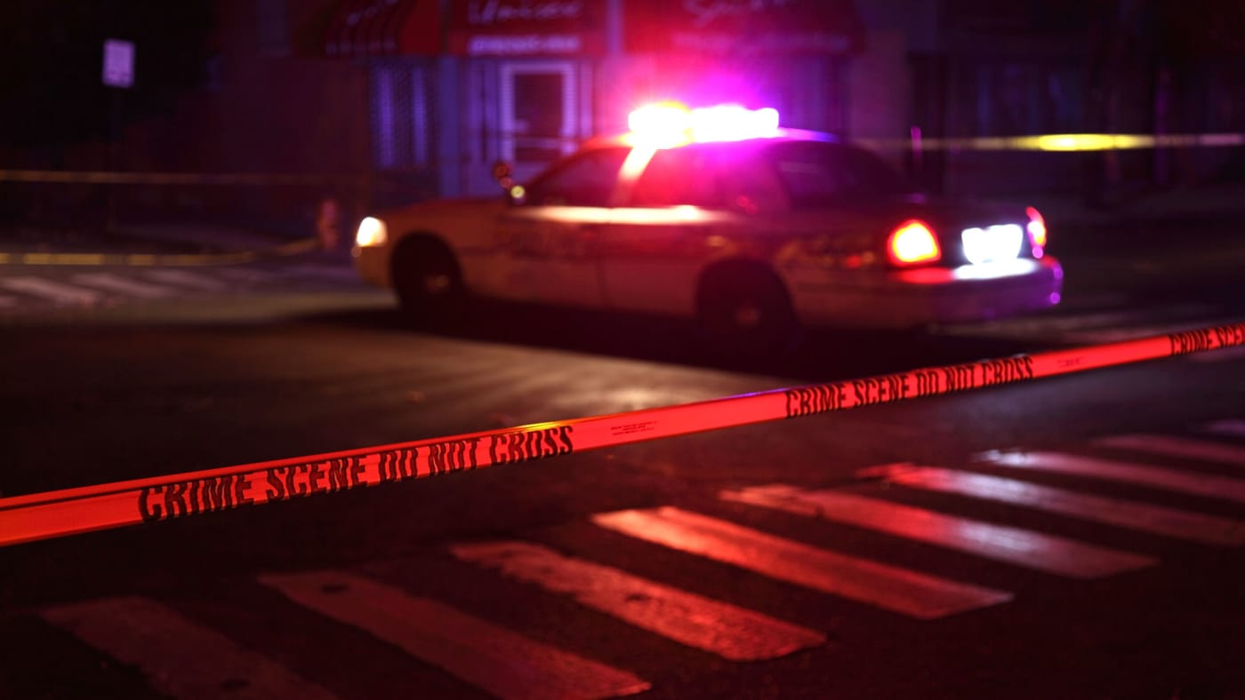 Police close off a crime scene.