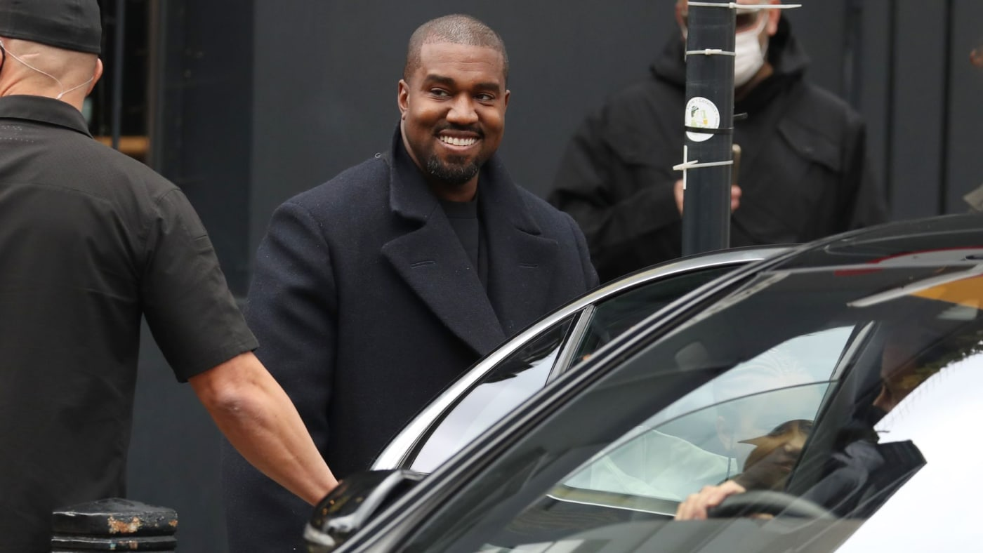 Kanye West going into car.