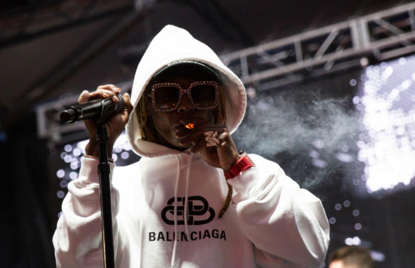 Rapper Lil Wayne performs onstage during JMBLYA at Fair Park