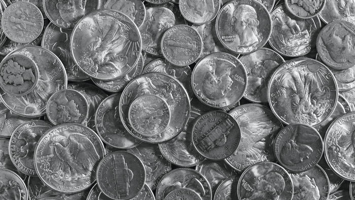Pile of various old silver coins, close-up.