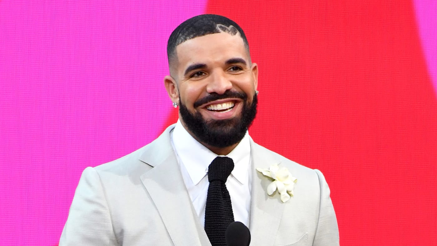 Drake, winner of the Artist of the Decade Award, and Adonis Graham speak onstage for the 2021 Billboard Music Awards, broadcast on May 23, 2021.
