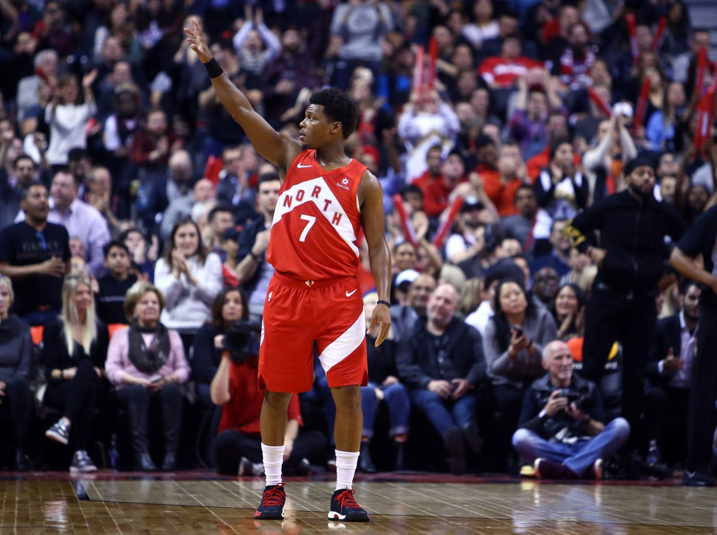 Kyle Lowry waves at fans at Toronto's Scotiabank Arena