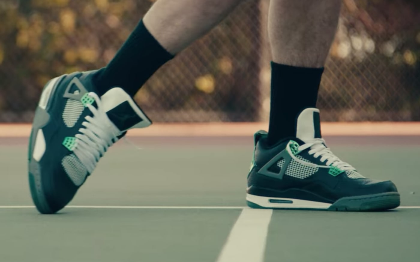 A pair of Oregon Air Jordan 4s gets scuffed in the Netflix show Sneakerheads