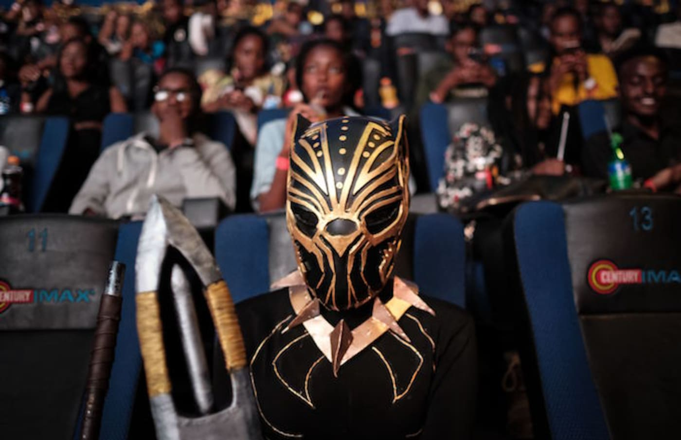 A cosplayer poses before watching the film 'Black Panther.'