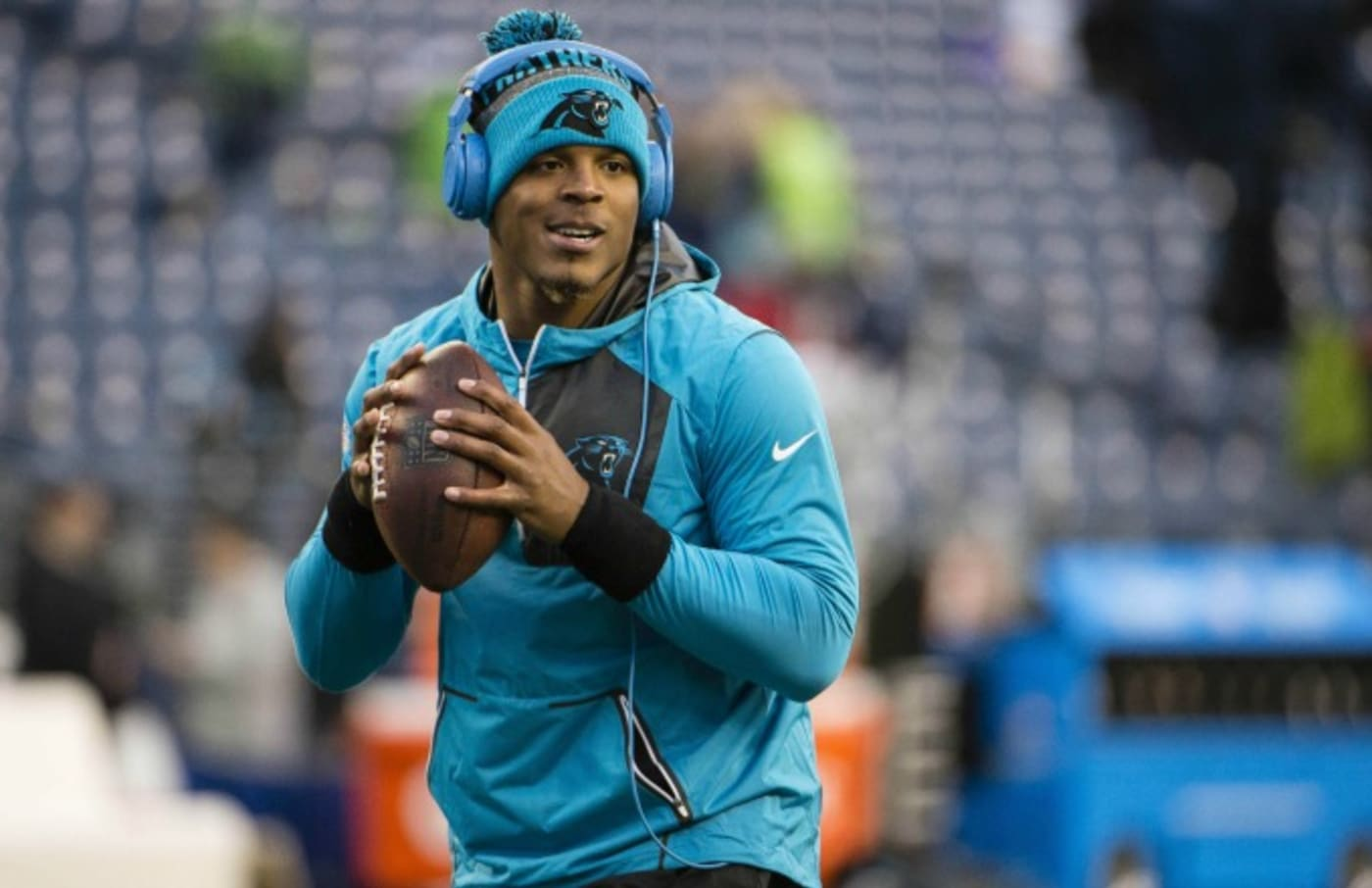 Cam Newton warms up before a game against the Seahawks.