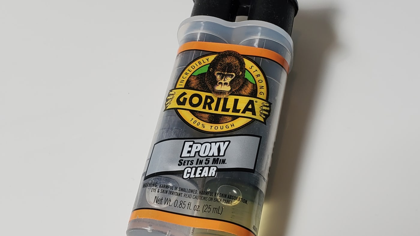 Close-up shot of a Gorilla Glue epoxy glue bottle with the company logo prominent.