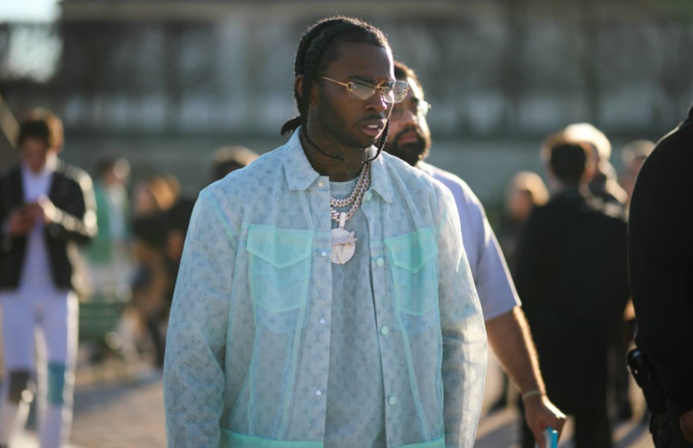 Pop Smoke is wearing a Louis Vuitton look before the Louis Vuitton AW20 Men Show