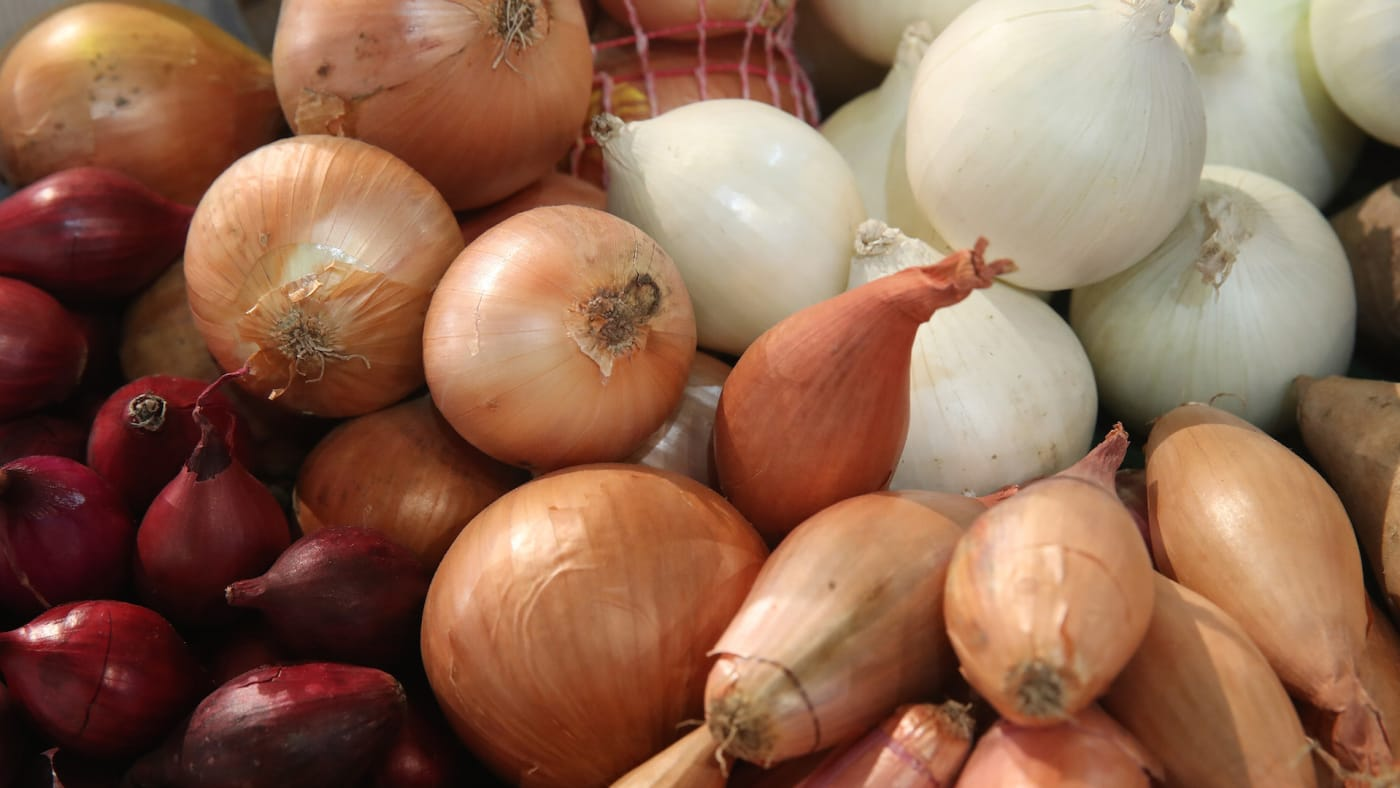 Onions and shallots lie on display at the 2018 International Green Week