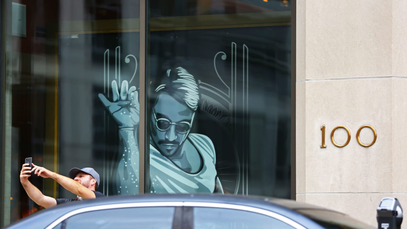 An unidentified man parks and takes a selfie next to the restaurant Nusr-Et.